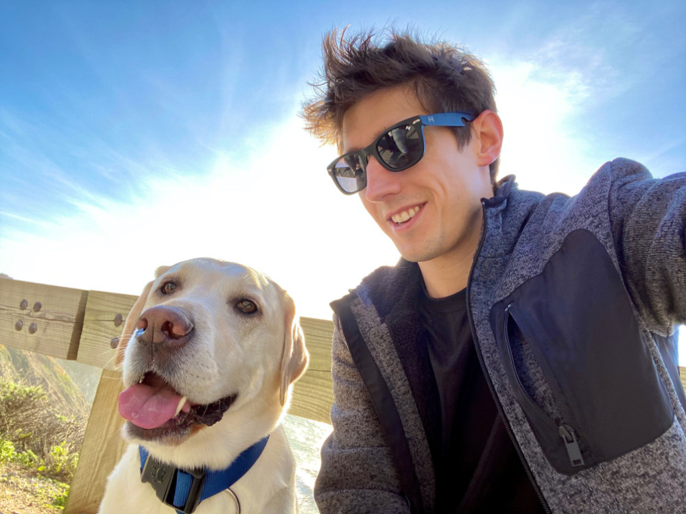 (photo of Marcus and his dog, Riker)